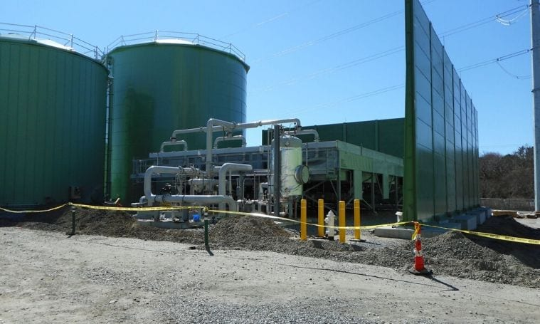 Oil silos at an oil and gas processing plant.